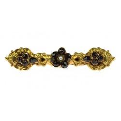 Gold brooch with czech garnet