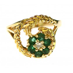 Gold ring with emeralds and...