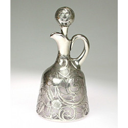 Glass decanter with silver
