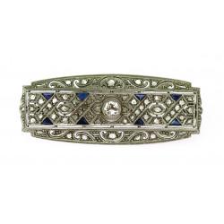 Zlatá brož s diamanty a safíry
