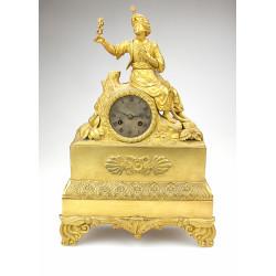 Bronzové hodiny s mouřenínem