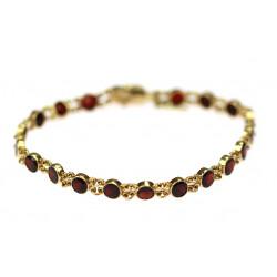 Gold bracelet with garnets...