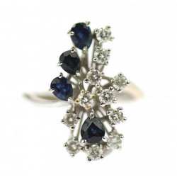 Gold brilliant cut diamond ring decorated with sapphires