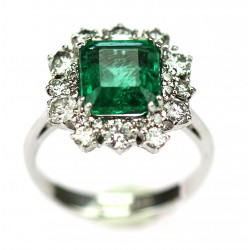 Gold ring with emerald and...