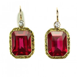 Gold earrings with...