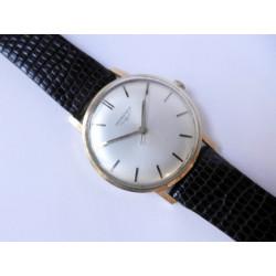 Gold Longines watch