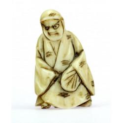 Necuke - figura v kápi
