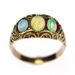 Golden ring with opals