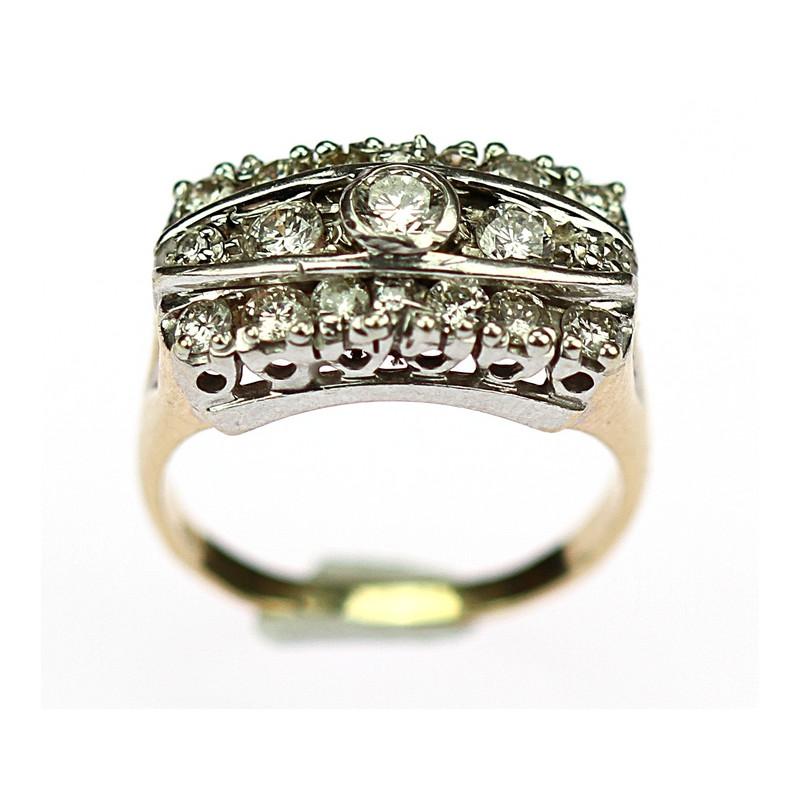 c8ec2bab7 Zlatý prsten vyrobený v kombinaci bílého a žlutého 14 karátového zlata  zdobený diamanty. Centrální briliant o váze 0,20 ct, barvy G, čistoty Si 1.