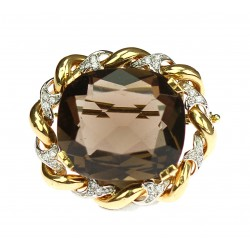Gold brooch with smoky...