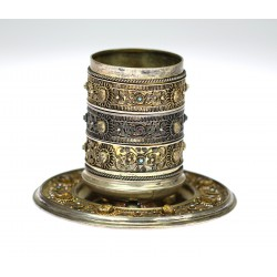 Silver cup with a saucer