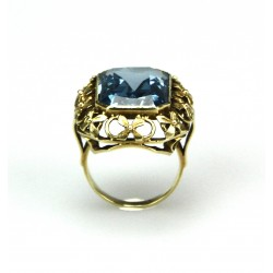 Gold ring with synthetic...