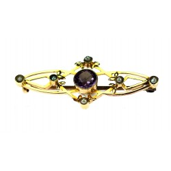 Gold brooch with amethyst...