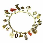 """Zlatý náramek """"žebrák"""" s 19 přívěsky pro štěstí! Typický art-deco článkový náramek vyrobený ve 20.- 30. letech 20. století v Československu. . . . Gold bracelet """"beggar"""" with 19 pendants for good luck! A typical art-deco bracelet made in the 1920s and 1930s in Czechoslovakia. . . . 25 000 Kč / 926 € . . . . #cinolterantique #distinctive #bracelet #žebrák #gold #zlatnik #sperkar  #pes #slon #gemmstone  #srdce #pavoucek #igerscz #iglifecz #oldtown #podkova  #lev  #old  #štěstí #leto #ano#rubyline #antique #antik #starozitnost #fashioninsta #slowfashion #dnesnosim #artdeco"""